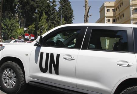 A U.N. vehicle carrying United Nations chemical weapons experts is seen at Yousef al-Azma military hospital in Damascus August 30, 2013. REUTERS/Khaled al-Hariri