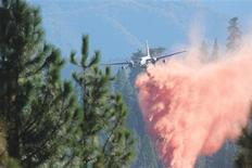 A tanker drops retardant on the Rim Fire in this undated United States Forest Service handout photo near Yosemite National Park, California, released to Reuters August 30, 2013. Fire crews battling to outflank a monster wildfire inside Yosemite National Park made headway on Friday in confining flames to wilderness areas but were powerless to salvage the region's sputtering tourist economy at the end of its peak summer tourist season. REUTERS/Mike McMillan/U.S. Forest Service/Handout via Reuters