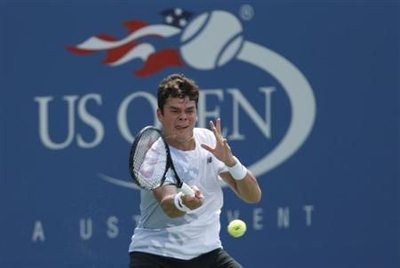 Milos Raonic of Canada hits a return to Feliciano Lopez of Spain at the U.S. Open tennis championships in New York August 31, 2013. REUTERS/Eduardo Munoz
