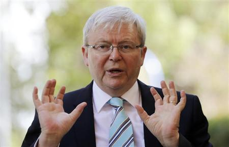 Australian Prime Minister Kevin Rudd gestures as he talks to parents at the Mascot Early Childhood Centre as part of his election campaign in Sydney August 26, 2013. REUTERS/Daniel Munoz