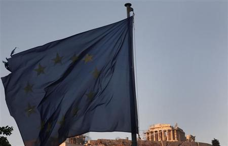 An European Union flag flutters in front of the Parthenon temple in Athens August 20, 2013 . REUTERS/John Kolesidis