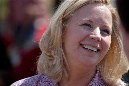 Senate candidate Liz Cheney speaks with voters during a Republican and Tea Party gathering in Emblem, Wyoming August 24, 2013. REUTERS/Ruffin Prevost