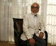 """Japanese director Hayao Miyazaki of the animated movie """"Ponyo"""" smiles as he poses for a picture in Los Angeles July 28, 2009. REUTERS/Mario Anzuoni"""