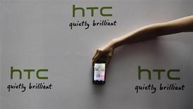 A new HTC Android-based smartphone Sensation is displayed during a news conference for the launch of the product in Taipei May 27, 2011. REUTERS/Pichi Chuang