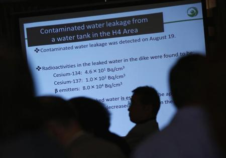 A screen showing the current situation of the contaminated water leakage in Tokyo Electric Power Co (TEPCO)'s tsunami-crippled Fukushima Daiichi nuclear power plant is displayed near reporters, during Japan's Nuclear Regulation Authority (NRA) Chairman Shunichi Tanaka's (not pictured) news conference at the Foreign Correspondents' Club of Japan in Tokyo September 2, 2013. REUTERS/Issei Kato