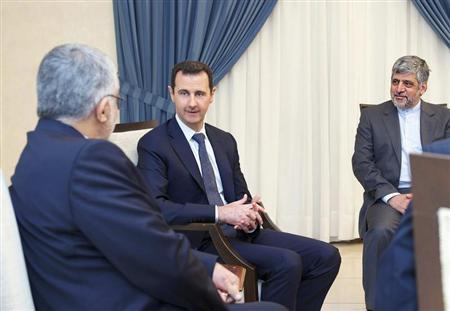 Syria's President Bashar al-Assad (C) meets Alaeddin Boroujerdi (L), head of the Iranian parliamentary committee for national security and foreign policy, in Damascus September 1, 2013 in this handout released by Syria's national news agency SANA. REUTERS/SANA/Handout via Reuters