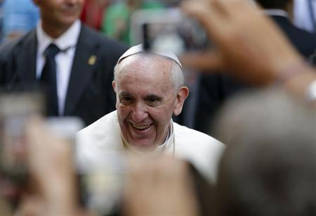 Pope Francis smiles as he arrives for a private visit at the Saint Agostino church in Rome August 28, 2013. REUTERS/Max Rossi