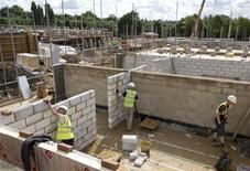 Construction workers build a new residential property development in north London, August 6, 2013. REUTERS/Neil Hall