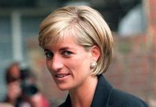 Princess Diana arrives at the Royal Geographical Society in London for a speech on the dangers of landmines throughout the world June 12, 1997. REUTERS/Ian Waldie