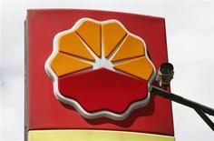 A security camera is seen in front of the logo of Petrochina at its gas station in Beijing August 29, 2013. REUTERS/Kim Kyung-Hoon
