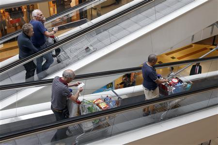 Customers push shopping trolleys on an escalator at the Bercy shopping centre in Charenton Le Pont, near Paris, August 29, 2013. REUTERS/Charles Platiau