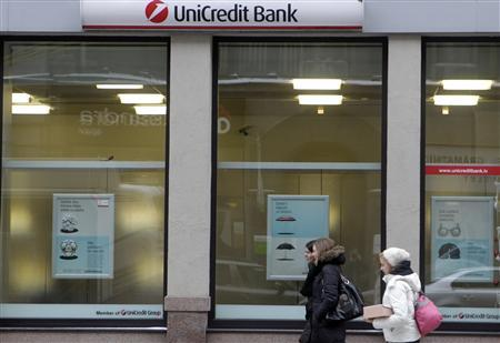 People walk past UniCredit Bank branch in Riga February 13, 2012. REUTERS/Ints Kalnins