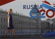 An employee passes by a sign at the main press centre of the G20 summit in Strelna near St. Petersburg September 4, 2013. REUTERS/Alexander Demianchuk