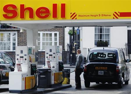 A driver fills up with fuel at a Shell petrol station in London May 15, 2013. REUTERS/Luke MacGregor