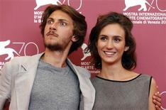 """Actors Gabriele Rendina and Livia Rossi (R) pose during a photocall for the movie """"L'Intrepido"""", directed by Gianni Amelio, during the 70th Venice Film Festival in Venice September 4, 2013. REUTERS/Alessandro Bianchi"""