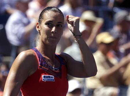 Flavia Pennetta of Italy reacts after defeating compatriot Roberta Vinci at the U.S. Open tennis championships in New York September 4, 2013. REUTERS/Shannon Stapleton