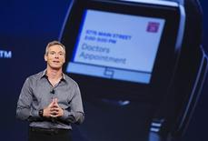 """Paul Jacobs, chairman and CEO of Qualcomm, talks about the new """"Toq"""" smartwatch at the Uplinq 2013 conference in San Diego, California, September 4, 2013. REUTERS/Fred Greaves"""
