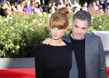 "Director Amos Gitai (R) poses with actress Yuval Scharf during a red carpet for the movie ""Ana Arabia"" during the 70th Venice Film Festival in Venice September 3, 2013. REUTERS/Alessandro Bianchi"