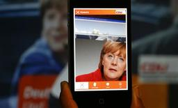 A 'Merkel app' with a portrait of German Chancellor Angela Merkel is pictured on a smartphone in Berlin, September 5, 2013. REUTERS/Pawel Kopczynski