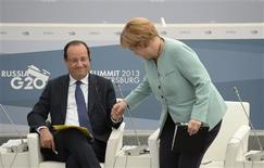 German Chancellor Angela Merkel (R) and French President Francois Hollande attend a meeting with business leaders in St.Petersburg September 6, 2013. REUTERS/Alexei Filippov/RIA Novosti/Pool