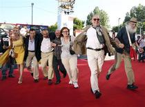 "Director Gianfranco Rosi (2nd R) poses with his cast during a red carpet for the movie ""Sacro Gra"" at the 70th Venice Film Festival September 5, 2013. REUTERS/Alessandro Bianchi"