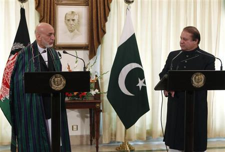 Afghan President Hamid Karzai (L) speaks during a joint news conference as Pakistan's Prime Minister Nawaz Sharif listens at the prime minister's residence in Islamabad August 26, 2013. REUTERS/Mian Khursheed