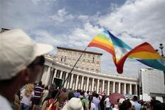 A man waves a peace flag as Pope Francis leads his Sunday angelus prayer in Saint Peter's Square at the Vatican September 8, 2013. REUTERS/Tony Gentile