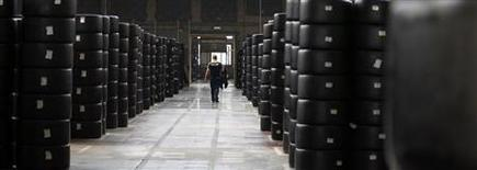 A worker walks past motorsport racing tyres stocked in the Michelin tyre company's factory in Clermont-Ferrand, central France, July 10, 2013. REUTERS/Regis Duvignau