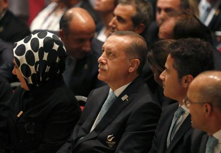 Turkish Prime Minister Tayyip Erdogan sits with members of the Istanbul bid committee after Jacques Rogge President of the International Olympic Committee (IOC) announced Tokyo as the city to host the 2020 Summer Olympic Game during a ceremony in Buenos Aires September 7, 2013. REUTERS/Enrique Marcarian