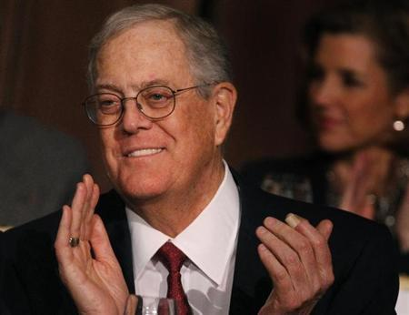 David Koch, executive vice president of Koch Industries, applauds during an Economic Club of New York event in New York, December 10, 2012. REUTERS/Brendan McDermid