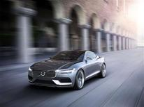 An undated handout picture provided to Reuters on September 4, 2013 shows a Volvo Concept Coupe driving past a building. REUTERS/Volvo Cars/Handout via Reuters