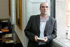 "Irish author Colm Toibin poses for photographers after he won the world's richest literary prize for a single work of fiction in English on Tuesday for ""The Master"" in Dublin, Ireland June 13, 2006."