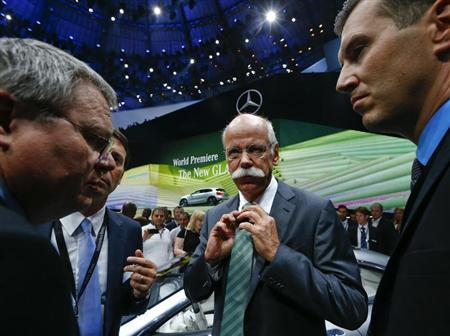 Daimler Chief Executive Dieter Zetsche (C) adjusts his tie during the presentation of the new SUV Mercedes GLA on a media preview day at the Frankfurt Motor Show (IAA) September 10, 2013. REUTERS/Ralph Orlowski