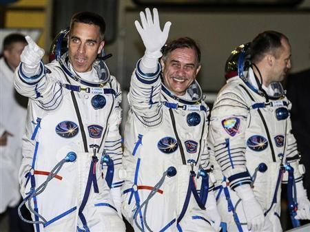 The International Space Station crew members (L to R) U.S. astronaut Chris Cassidy and Russian cosmonauts Pavel Vinogradov and Alexander Misurkin walk after donning space suits before the launch at the Baikonur cosmodrome March 28, 2013. REUTERS/Sergei Ilnitsky/Pool