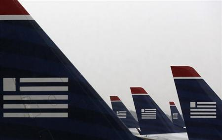 U.S. Airways jets are seen at Reagan National Airport in Washington July 12, 2013. REUTERS/Larry Downing