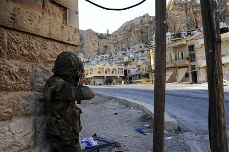 A member of the forces loyal to Syria's President Bashar al-Assad is seen at Maloula village northeast of Damascus, in this handout photograph distributed by Syria's national news agency SANA on September 11, 2013. REUTERS/SANA/Handout via Reuters