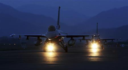 KF-16 fighter jets of the South Korean air force prepare to take off during a night flight operation at an air base in Chungju, about 100 km (62 miles) southeast of Seoul in this picture taken April 17, 2013 and released April 18, 2013. REUTERS/South Korean Air Force/Handout