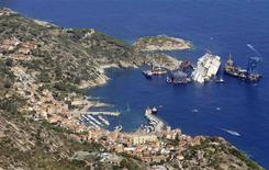 An aerial view shows the Costa Concordia as it lies on its side next to Giglio Island taken from an Italian navy helicopter August 26, 2013. REUTERS/Alessandro Bianchi