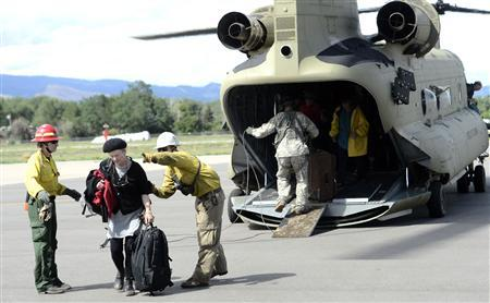 Four dead in Colorado flooding as rescues continue