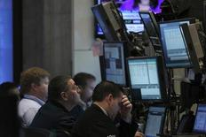 Traders work on the floor of the New York Stock Exchange, September 13, 2013. REUTERS/Brendan McDermid