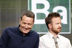 """Cast member Bryan Cranston (L) smiles next to co-star Aaron Paul at a panel for the television series """"Breaking Bad"""" during the AMC portion of the Television Critics Association Summer press tour in Beverly Hills, California July 26, 2013. REUTERS/Mario Anzuoni"""