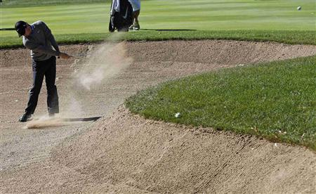 Rory McIlroy of Northern Ireland hits out of the sand trap the first hole during the second round of the BMW Championship golf tournament at the Conway Farms Golf Club in Lake Forest, Illinois, September 13, 2013. REUTERS/Jim Young