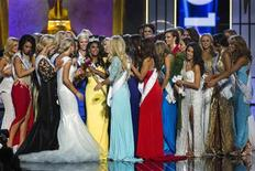Miss America contestant, Miss New York Nina Davuluri (in yellow) celebrates with other contestants after being chosen winner of the 2014 Miss America Pageant in Atlantic City, New Jersey, September 15, 2013. REUTERS/Lucas Jackson
