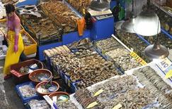 A fish dealer waits for customers at a fishery market in central Seoul September 13, 2013. REUTERS/Lee Jae-Won