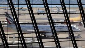 Le nouveau PDG d'Air France, Frédéric Gagey, devrait dévoiler mercredi de nouvelles mesures d'économies et de restructuration, notamment une réduction d'effectifs qui portera sur 2.600 à 3.000 postes. /Photo prise le 31 juillet 2013/REUTERS/Eric Gaillard