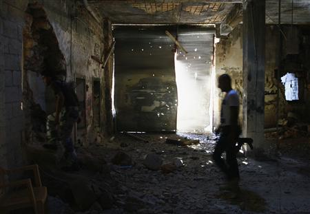 Free Syrian Army fighters walk through rubble inside the old city of Aleppo September 16, 2013. REUTERS/Nour Kelze