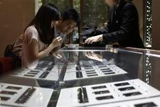 A couple selects diamond rings at a Tiffany store in Shanghai, September 16, 2013. REUTERS/Aly Song