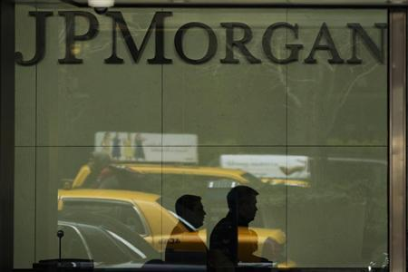 Two men walk past the front desk inside of the headquarters of JPMorgan Chase & Co bank in New York, March 15, 2013. REUTERS/Lucas Jackson