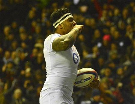 England's Manu Tuilagi celebrates after scoring a try during their Six Nations rugby match against France at Twickenham stadium in London February 23, 2013. REUTERS/Toby Melville