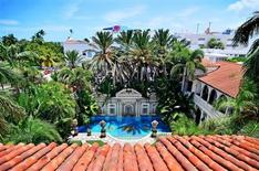 The view of the South Beach skyline and pool area of the South Beach mansion formerly owned by fashion designer Gianni Versace in Miami Beach, Florida July 23, 2013. REUTERS/Gaston De Cardenas